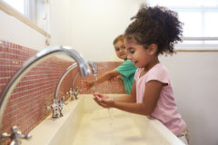 Pupils At Montessori School Washing Hands In Washroom