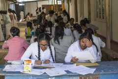 Pupils passing exam during lesson at school in Nuwara Eliya town. In Sri Lanka royalty free stock photography
