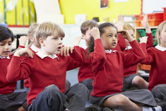 Pupils Perfoming Actions Whilst Singing Song Royalty Free Stock Photo