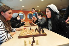 Pupils playing chess Stock Photos