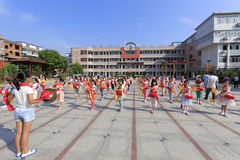 Pupils practice to play drum at the school square Stock Photo