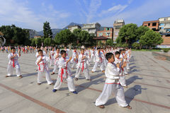 Pupils practice to play traditional martial arts at the school square Royalty Free Stock Photography
