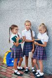 Portrait of school kids with backpack and books after school. Beginning of lessons. First day of fall. Pupils of primary school. Girls with backpacks and books Stock Images