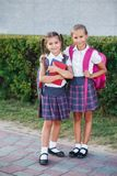 Portrait of school kids with backpack and books after school. Beginning of lessons. First day of fall. Pupils of primary school. Girls with backpacks and books Stock Photo