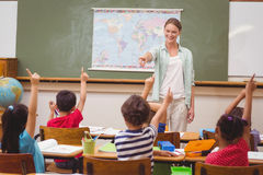 Pupils raising hand in classroom stock photo
