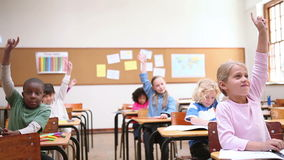 Pupils raising their fingers stock video footage