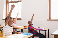 Pupils raising their hands during class Stock Images