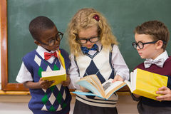 Pupils reading books Stock Images