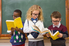 Pupils reading books Royalty Free Stock Photos