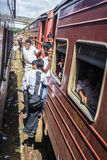 Pupils riding the train to Colombo Stock Images