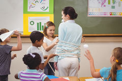 Pupils running wild in classroom. At the elementary school Royalty Free Stock Photography