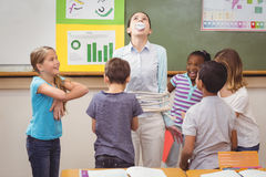 Pupils running wild in classroom Stock Images
