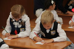 Pupils at a school desk at a lesson at school - Russia Moscow the first High School the first class b - September 1 2016 Stock Photo