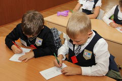 Pupils at a school desk at a lesson at school - Russia Moscow the first High School the first class b - September 1 2016 Stock Images