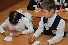 Pupils at a school desk at a lesson at school - Russia Moscow the first High School the first class b - September 1 2016 Royalty Free Stock Photo
