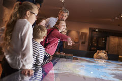 Pupils On School Field Trip To Museum Looking At Map Stock Images