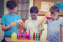 Pupils at science lesson in classroom Royalty Free Stock Photos