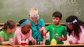 Pupils at science lesson in classroom. At the elementary school stock footage