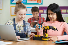 Pupils In Science Lesson Studying Robotics. Pupils In Science Lesson Study Robotics Stock Photography