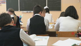 Pupils sit at a school desks on a lesson at school stock footage