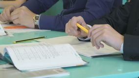 The pupils sitting at the school desk indoors stock video