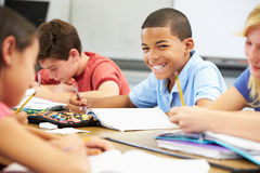 Pupils Studying At Desks In Classroom Stock Photos