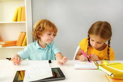 Pupils studying in elementary school Royalty Free Stock Photos