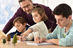 Pupils taking notes in science class Stock Photography