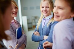 Pupils talking Stock Images