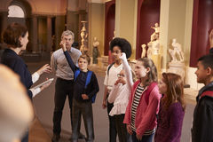 Pupils And Teacher On School Field Trip To Museum With Guide Stock Photos