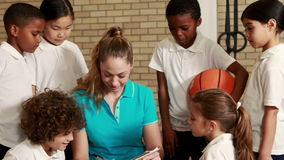 Pupils and teacher during sports lesson. At the elementary school stock footage