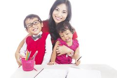 Pupils with their mother Stock Photos