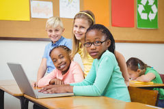 Pupils using a laptop in class Royalty Free Stock Photos