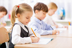 Pupils are writing in their copybooks Royalty Free Stock Images