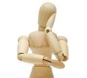 Puppe, die seine Backe auf seiner Hand stillstehen Lizenzfreie Stockfotos