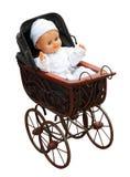 Puppe im Weinlese Pram Lizenzfreies Stockfoto