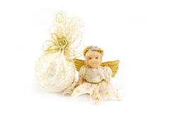 Puppe und Geschenke Stockfoto