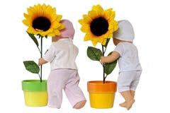Puppe und Sonnenblume Lizenzfreies Stockfoto