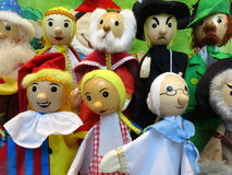 Puppet characters. Colorful hand puppets on a stick on display. Hand-crafted and ready for a puppet show Stock Image