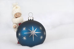 Puppet with christmas bauble Stock Photo