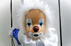 Puppet clown. View of a cute puppet clown collection, very close on her swing Royalty Free Stock Photos