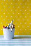Puppet and colored wood sticks. In white cup on colorful background Stock Photography