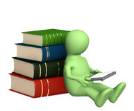 Puppet with e-book and books Stock Photo