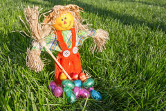 Puppet with eggs. A puppet with colorful chocolate eggs Stock Photography