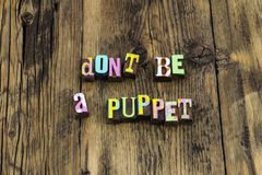 Puppet follow lead leadership independent honest trust success. Letterpress letters dont be independence free leader integrity stock photos