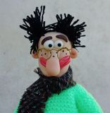 Puppet gentleman. Cold porcelain clay sculpted puppet Stock Photo