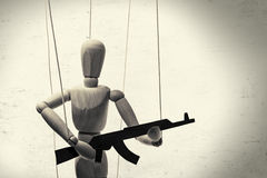 Puppet with  gun b/w Royalty Free Stock Photography