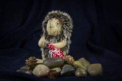 Puppet hedgehog with a bag on the stones Stock Photography