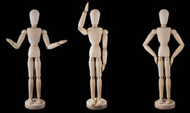 Puppet isolated on black. Three posing puppets represent human actions. The objects are isolated on black royalty free stock images