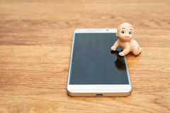 Puppet kid on the smartphone Royalty Free Stock Photos